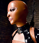 Hot blonde bound in latex and shocked