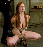 Pretty redhead roped, clamped and fucked