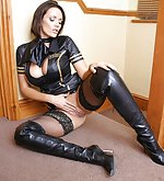 Busty brunette in latex dress and high boots