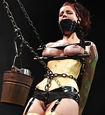 Redhead in latex and chains - clamped, vibed and dildoed
