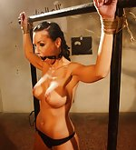 Bound to rack, ball-gagged, tit-grabbed, ass-slapped