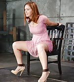 Cute redhead cuffed to the chair and face-fucked