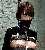 Ryan in latex bondage and lesbian sm