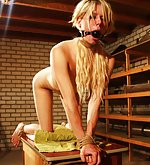 Roped on the table for humiliating dildo games