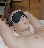 Rose gets tied to the bed and blindfolded