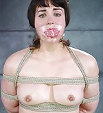 Roped, nipples camped, tightly gagged and hooded