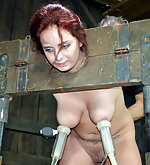Redhead gets cuffed, locked, caned and milked